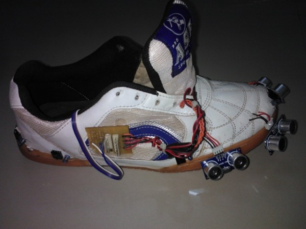 Arduino Based Sensor Shoes Assist Visually Impaired